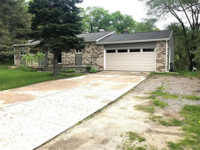 8265 Fieldcrest Dr, Brighton, MI 48116 (MLS #219048941) :: The John Wentworth Group