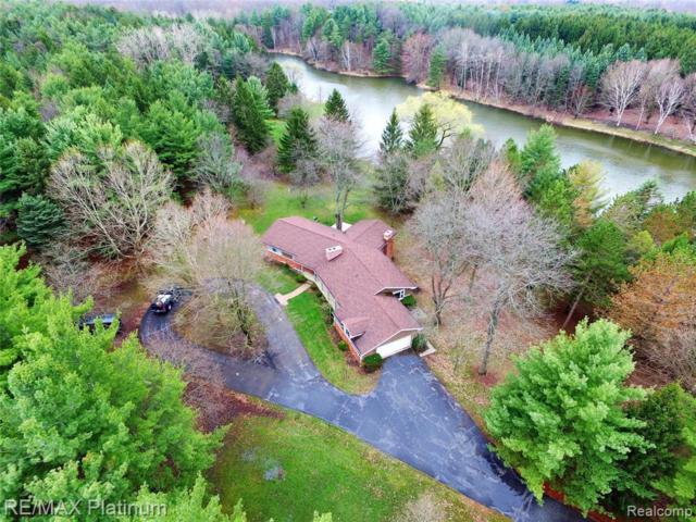 3296 Curdy Rd, Howell, MI 48855 (MLS #219047419) :: The John Wentworth Group