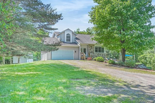 4438 Lahring Rd, Holly, MI 48442 (MLS #219056767) :: The John Wentworth Group