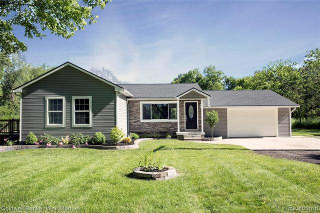 6440 Perryville Rd, Holly, MI 48442 (MLS #219057443) :: The John Wentworth Group