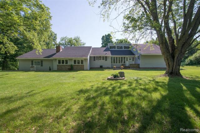 3990 Old Homestead Dr, Howell, MI 48855 (MLS #219054963) :: The John Wentworth Group