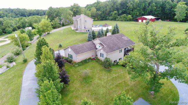 10770 Gloria Greer Ln, Holly, MI 48442 (MLS #219071599) :: The John Wentworth Group