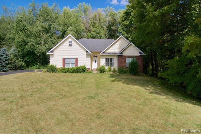5232 Universe Ave, Howell, MI 48843 (MLS #219084639) :: The John Wentworth Group