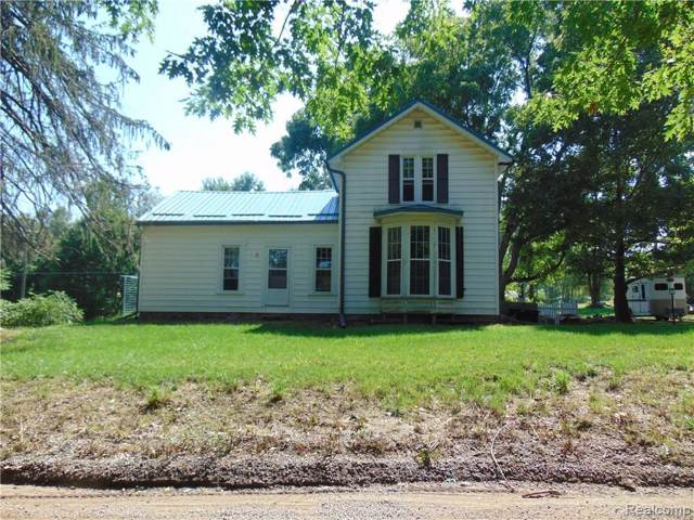 7222 Tucker Rd, Holly, MI 48442 (MLS #219086087) :: The John Wentworth Group