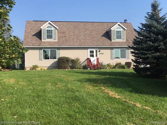285 N Hughes Rd, Howell, MI 48843 (MLS #219106480) :: The John Wentworth Group