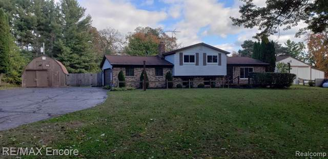7820 Milford Rd, Holly, MI 48442 (MLS #219106578) :: The John Wentworth Group