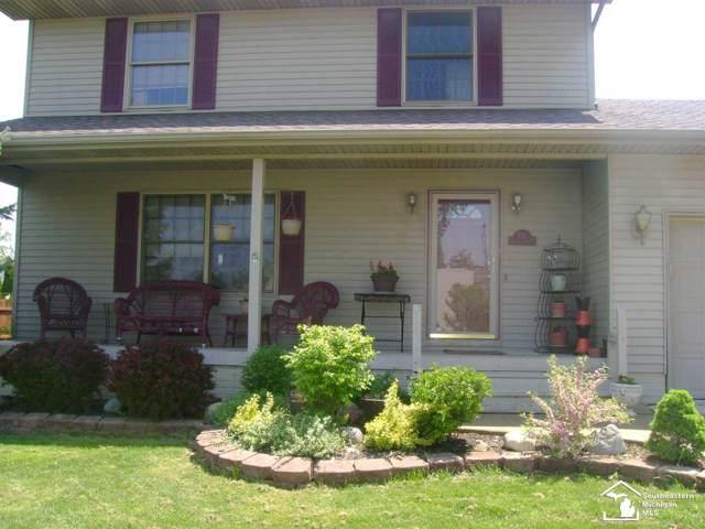 735 Toledo Ave, Monroe, MI 48161 (MLS #31391352) :: The John Wentworth Group