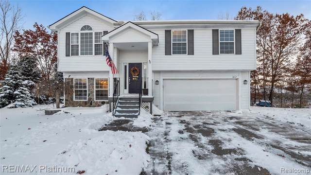 1867 Andover Crt, Howell, MI 48843 (MLS #219115672) :: The John Wentworth Group