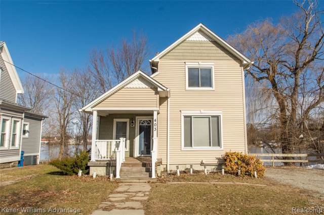 403 E Maple St, Holly, MI 48442 (MLS #2200009139) :: The John Wentworth Group
