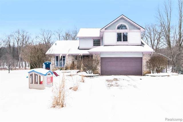 3932 Indian Camp Trl, Howell, MI 48855 (MLS #2200012132) :: The John Wentworth Group