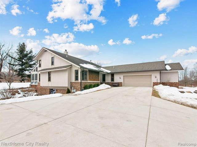 6575 Hadley Hills Crt, Clarkston, MI 48348 (MLS #2210013813) :: The BRAND Real Estate