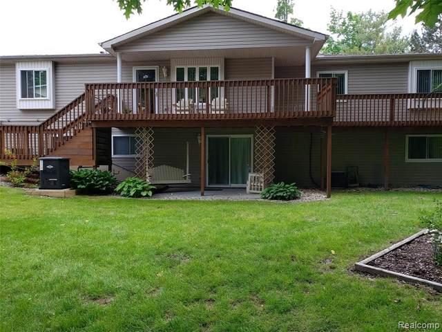 9554 Woodside Cir, Grand Blanc, MI 48439 (MLS #2210026094) :: The BRAND Real Estate
