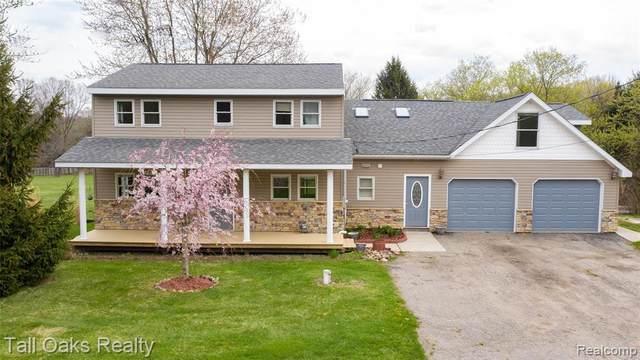 9700 Ortonville Rd, Clarkston, MI 48348 (MLS #2210027519) :: The BRAND Real Estate