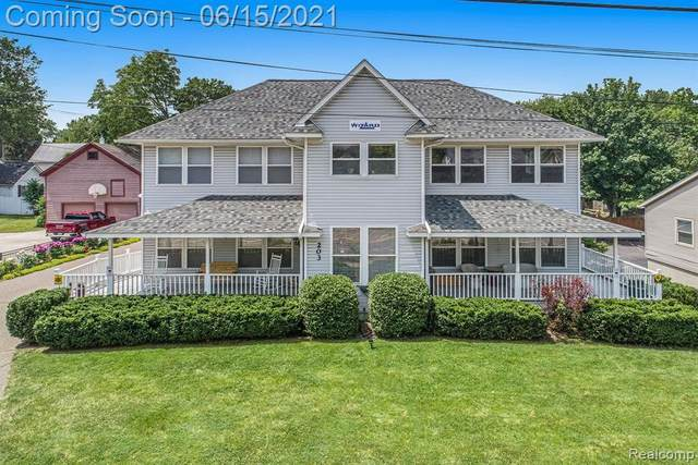 203 N Saginaw St, Holly, MI 48442 (MLS #2210044081) :: The BRAND Real Estate