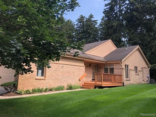 35305 Blue Spruce Dr Unit#124-Bldg#G, Farmington Hills, MI 48335 (MLS #2210067146) :: The BRAND Real Estate