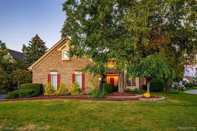 40040 Millpond Crt, Northville, MI 48168 (MLS #2210078436) :: The BRAND Real Estate