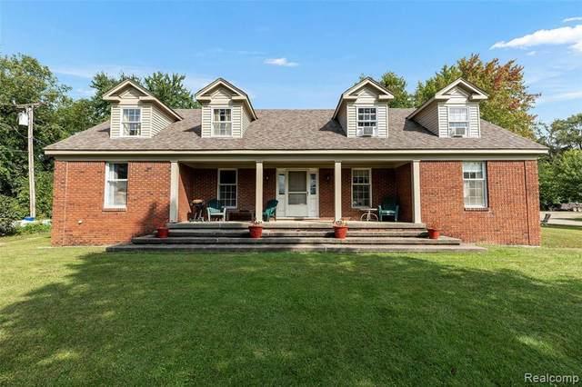 13895 Hibner Rd, Hartland, MI 48353 (MLS #2210087337) :: The BRAND Real Estate