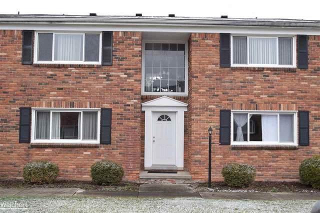 31831 Grand River Ave Unit 100 #100, Farmington, MI 48336 (MLS #50032534) :: The BRAND Real Estate