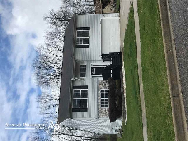 713 Carriage Hill Dr., Fenton, MI 48430 (MLS #50038984) :: The BRAND Real Estate