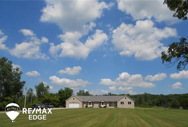 6386 W Carpenter, Flushing, MI 48433 (MLS #50044909) :: The BRAND Real Estate