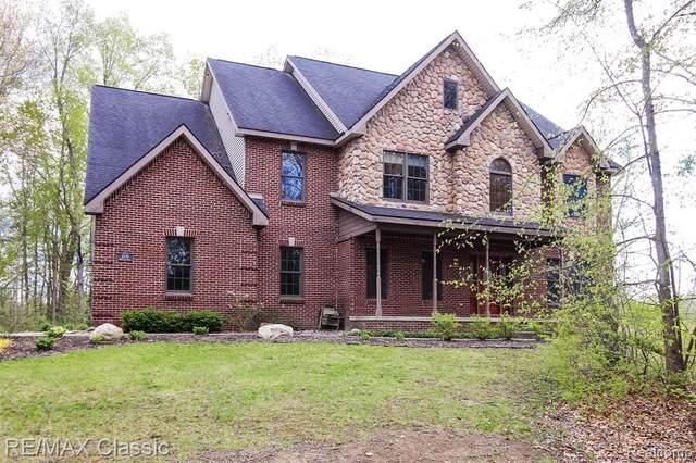 2270 Bullard Rd, Hartland, MI 48353 (MLS #2210033590) :: The BRAND Real Estate