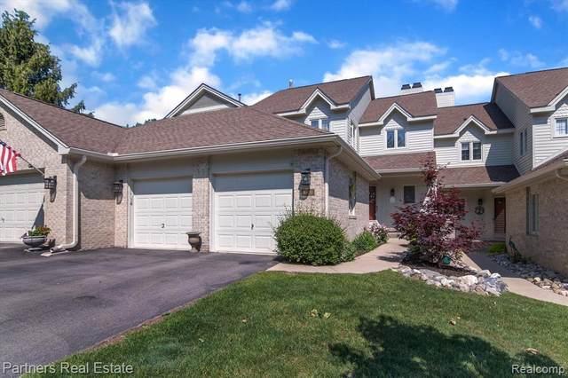 4470 Golf View Dr, Brighton, MI 48116 (MLS #2210041949) :: The BRAND Real Estate