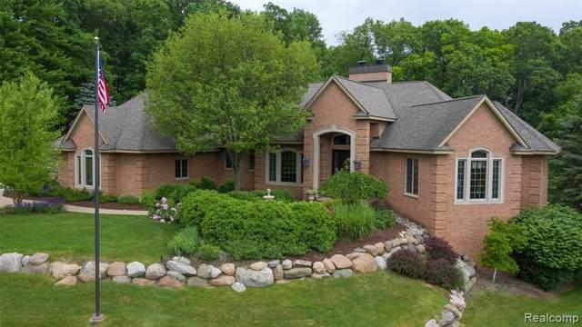 8418 Deerwood Rd, Clarkston, MI 48348 (MLS #2210044268) :: The BRAND Real Estate