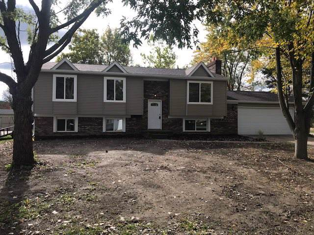 6288 Stonehearth Pass, Grand Blanc, MI 48439 (MLS #31398003) :: The John Wentworth Group