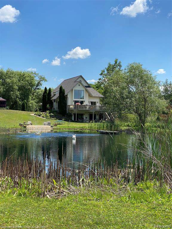 1697 N Hughes Rd, Howell, MI 48843 (MLS #2200050137) :: Scot Brothers Real Estate