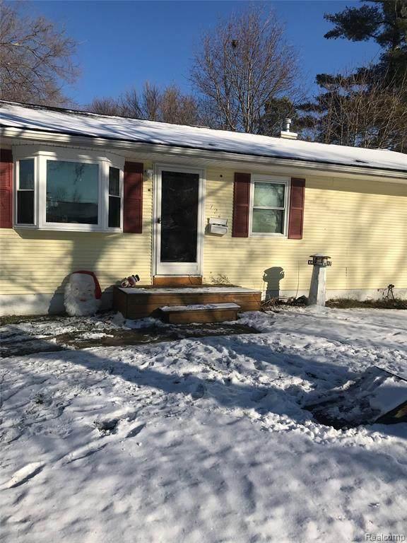 724 Hartner Dr, Holly, MI 48442 (MLS #2210006961) :: The BRAND Real Estate