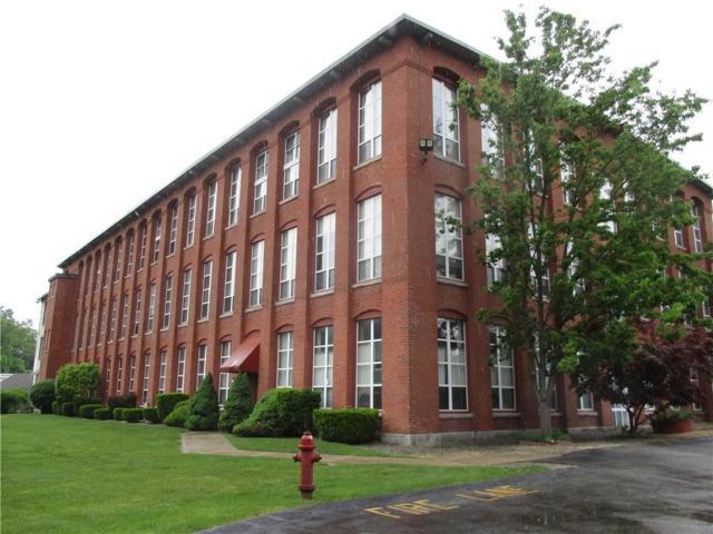 494 Woonasquatucket Av, Unit#218 #218, North Providence, RI 02911 (MLS #1193588) :: Albert Realtors