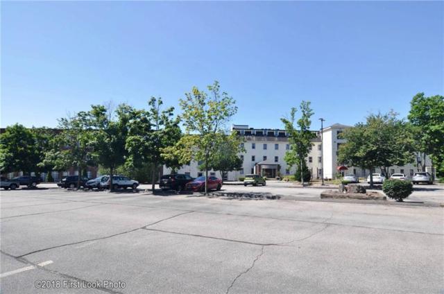 494 Woonasquatucket Av, Unit#412 #412, North Providence, RI 02911 (MLS #1204990) :: The Martone Group