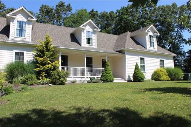 12 Ridgeland Road, Smithfield, RI 02917 (MLS #1239403) :: The Mercurio Group Real Estate
