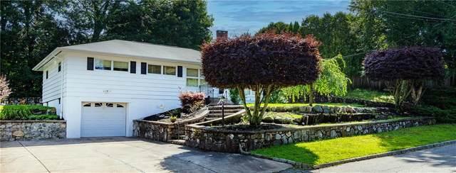 18 Woodstock Lane, Cranston, RI 02920 (MLS #1290443) :: The Seyboth Team
