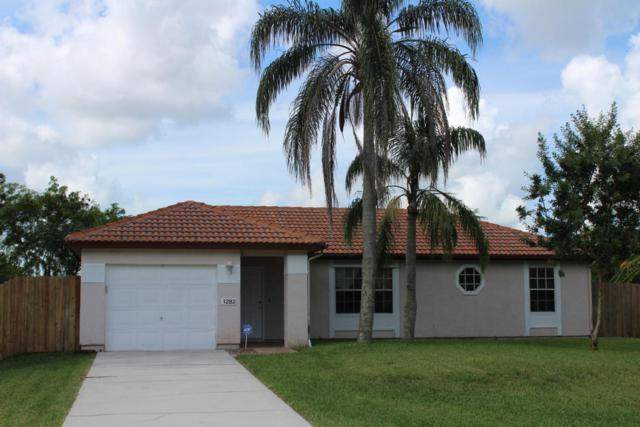 1282 SW Dalton Avenue, Port Saint Lucie, FL 34953 (#RX-10345363) :: The Carl Rizzuto Sales Team