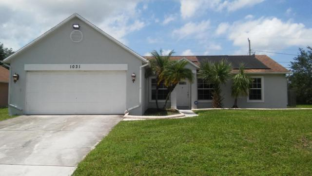 1031 SW Versailles Avenue, Port Saint Lucie, FL 34953 (#RX-10345448) :: The Carl Rizzuto Sales Team