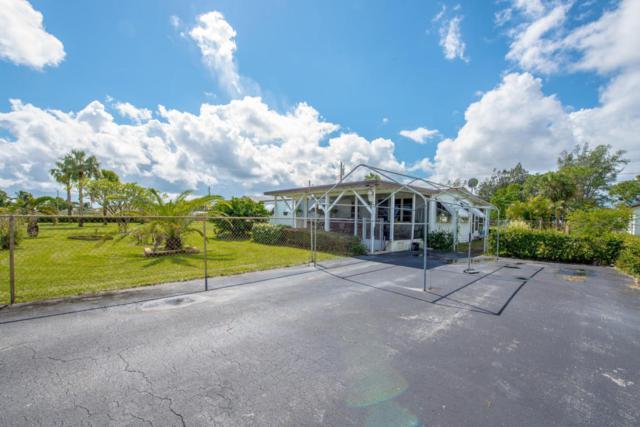 1569 W Breezy Lane, West Palm Beach, FL 33417 (#RX-10375536) :: The Carl Rizzuto Sales Team