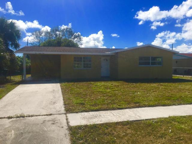 381 W 37 Street, Riviera Beach, FL 33404 (#RX-10382796) :: The Haigh Group | Keller Williams Realty