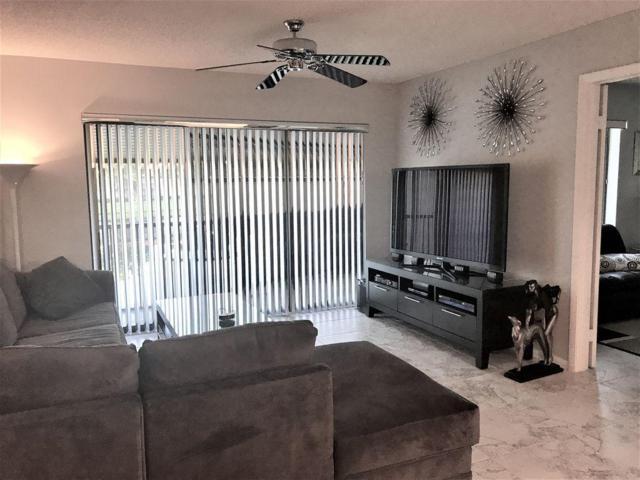 711 Sunny Pine Way G2, Greenacres, FL 33415 (#RX-10397158) :: The Carl Rizzuto Sales Team