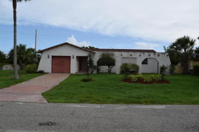 3931 Flag Drive, Palm Beach Gardens, FL 33410 (#RX-10434391) :: The Carl Rizzuto Sales Team