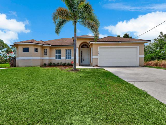 5781 NW Cotton Drive, Port Saint Lucie, FL 34986 (#RX-10434406) :: The Carl Rizzuto Sales Team