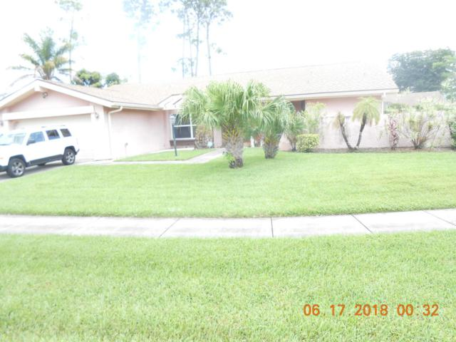12335 Sawgrass Court, Wellington, FL 33414 (#RX-10440471) :: United Realty Consultants, Inc