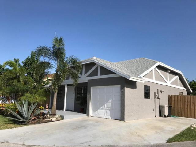 23345 Country Club Drive W, Boca Raton, FL 33428 (#RX-10449221) :: Atlantic Shores