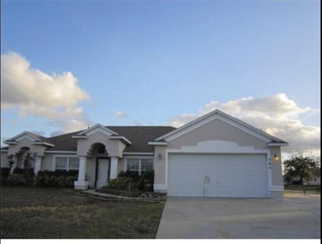 384 SW Millard Drive, Port Saint Lucie, FL 34953 (#RX-10449523) :: The Haigh Group | Keller Williams Realty
