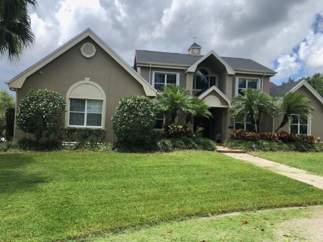 14161 64th Drive N, Palm Beach Gardens, FL 33418 (#RX-10471641) :: The Reynolds Team/Treasure Coast Sotheby's International Realty
