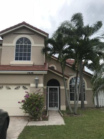 7636 Oakboro Drive, Lake Worth, FL 33467 (#RX-10473257) :: The Reynolds Team/Treasure Coast Sotheby's International Realty