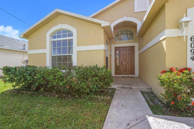 6094 Lauderdale Street, Jupiter, FL 33458 (#RX-10474241) :: The Reynolds Team/Treasure Coast Sotheby's International Realty