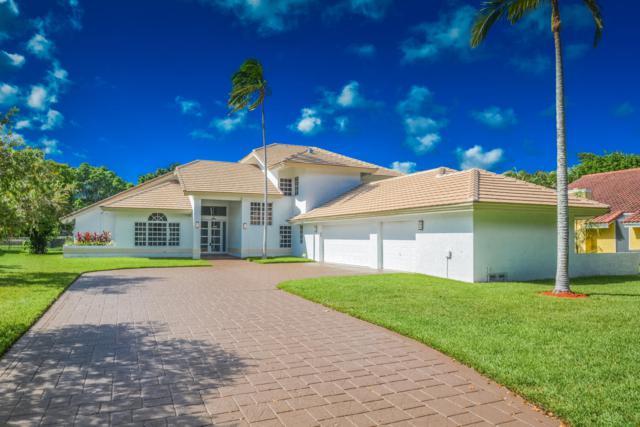 5551 NW 23rd Avenue, Boca Raton, FL 33496 (MLS #RX-10474404) :: Castelli Real Estate Services