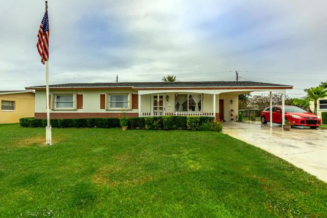 437 San Mateo Drive, Palm Springs, FL 33461 (#RX-10505541) :: The Rizzuto Woodman Team