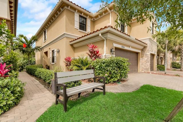 10334 Wellington Parc Drive, Wellington, FL 33449 (MLS #RX-10519348) :: Berkshire Hathaway HomeServices EWM Realty